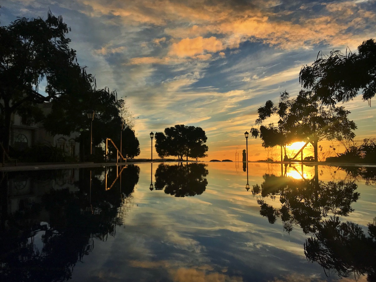 The reflection pool outside the IPJ at sunset, with strong hues of blue and orange.