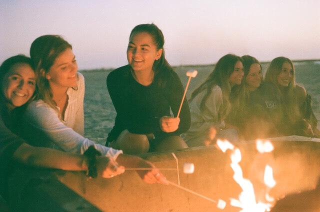 Roasting marshmallows at the beach